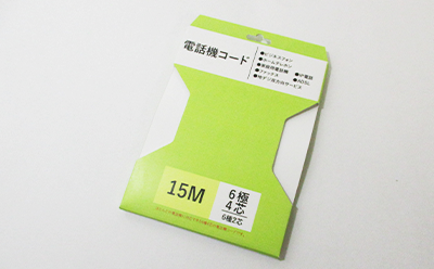 コードやケーブルなどの紐状の長い商品の巻いて梱包するパッケージのようなヤッコ型台紙